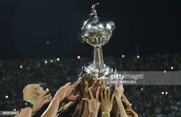 Colombia's Atletico Nacional players celebrate with the trophy after winning the 2016 Copa Libertadores at Atanasio Girardot stadium in Medellin...
