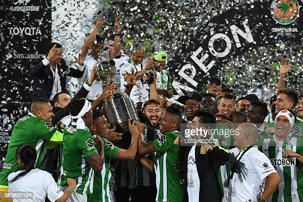 Colombia's Atletico Nacional players hold the trophy after winning the 2016 Copa Libertadores at Atanasio Girardot stadium in Medellin Antioquia...