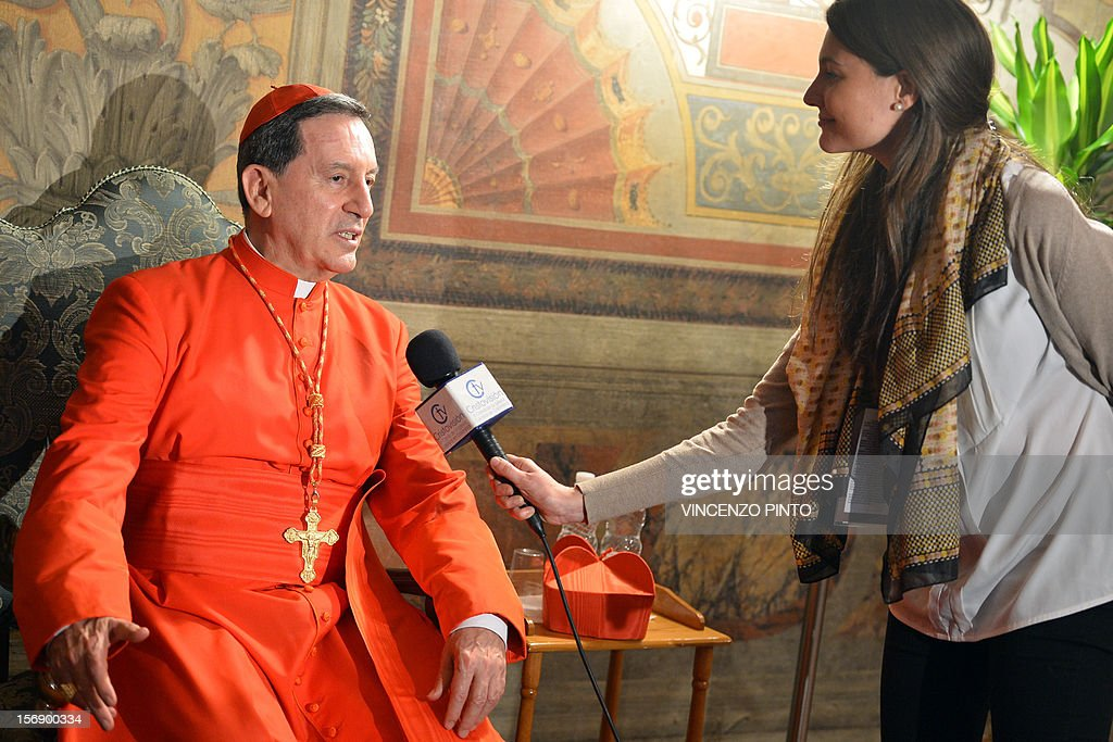 Colombia's cardinal Ruben Salazar Gomez speaks to a journalist during the courtesy visit after being appointed by the pontif on November 24, 2012 at the Apostolico palace at the Vatican. Six non-European prelates are set to join the Catholic Church's College of Cardinals, a move welcomed by critics concerned that the body which will elect the future pope is too Eurocentric.