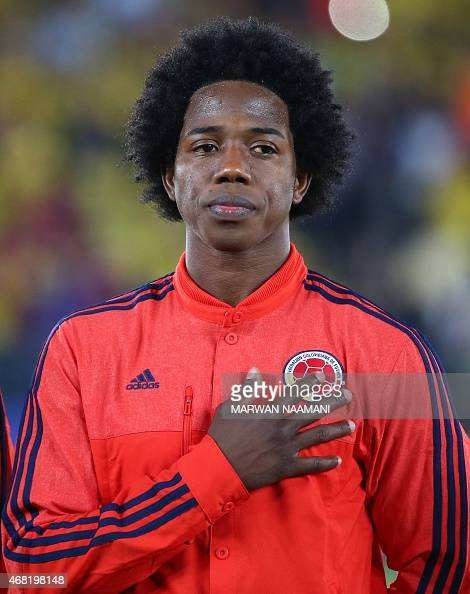 Colombia's Carlos Alberto Sanchez Moreno listens to his country's national anthem prior the start of his team's friendly football match against...