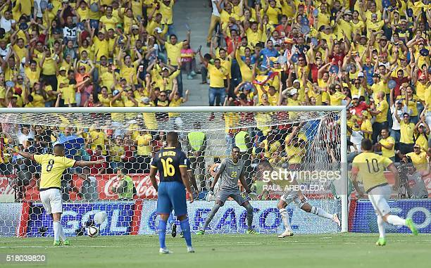 Colombia's Carlos Bacca celebrates after scoring against Ecuador during their Russia 2018 FIFA World Cup South American Qualifiers' football match in...