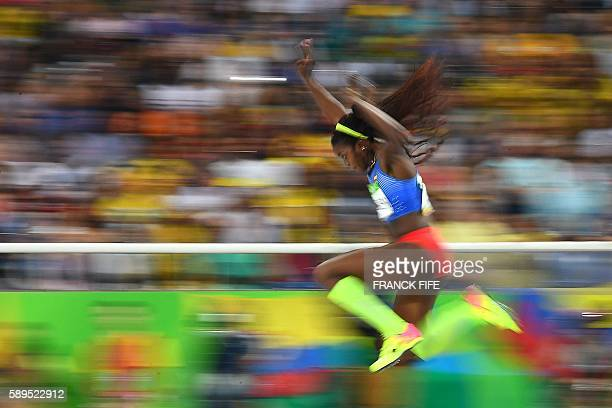 Colombia's Caterine Ibarguen competes in the Women's Triple Jump Final during the athletics event at the Rio 2016 Olympic Games at the Olympic...