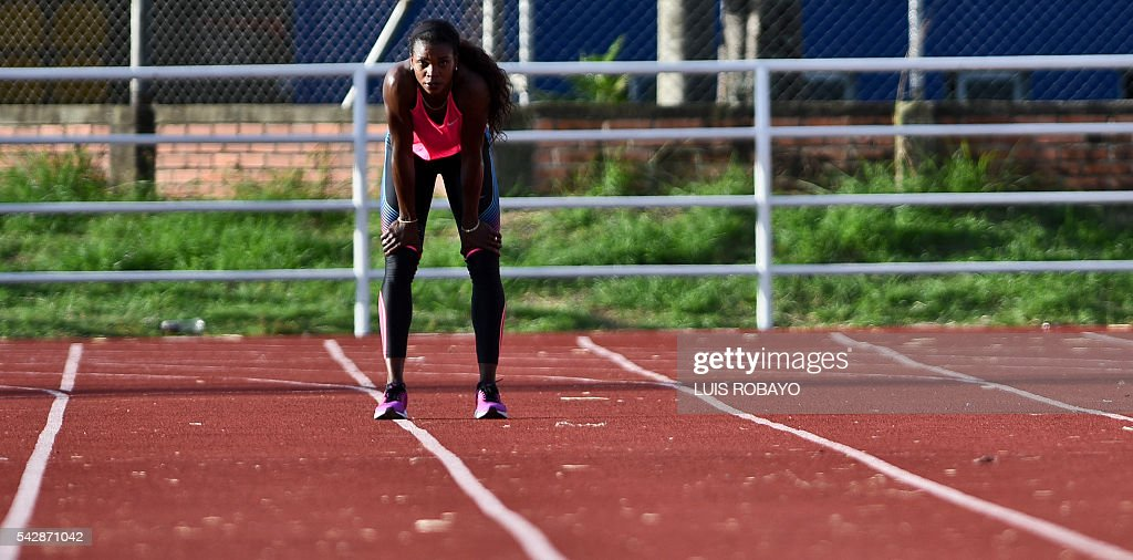 Colombia's Caterine Ibarguen eyes the running track during a training session prior to the International Athletics Grand Prix at Athletics Stadium Pedro Grajales in Cali, Colombia, on June 24, 2016. / AFP / LUIS
