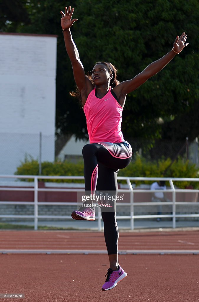 Colombia's Caterine Ibarguen warms up during a training session prior to the International Athletics Grand Prix at Athletics Stadium Pedro Grajales in Cali, Colombia, on June 24, 2016. / AFP / LUIS