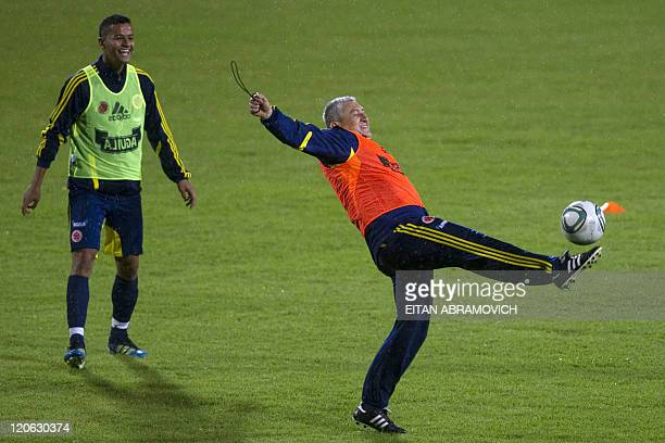Colombia's coach Eduardo Lara plays with the ball at the end of a training session for the FIFA World Cup U20 tournament in Bogota on August 7 2011...