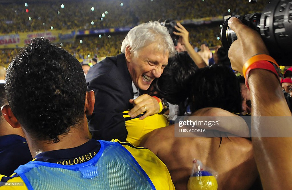 Colombia's coach Jose Pekerman and members of the team celebrates after qualifying for the Brazil 2014 FIFA World Cup after a 3-3 tie with Chile in a South American qualifier match, in Barranquilla, Colombia, on October 11, 2013. AFP PHOTO / LUIS ACOSTA