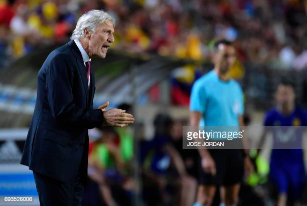 Colombia's coach Jose Pekerman applauds from the sideline during the friendly international football match Spain vs Colombia at the Condomina stadium...