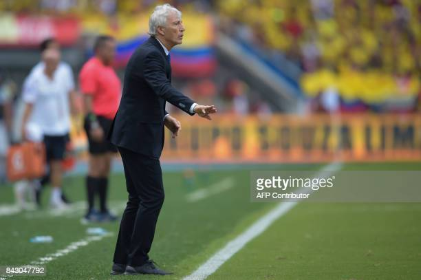 Colombia's coach Jose Pekerman gives instructions during the 2018 World Cup football qualifier match against Brazil in Barranquilla Colombia on...