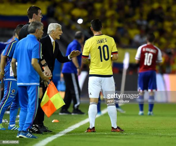 Colombia's coach Jose Pekerman gives instructions to Colombia's James Rodriguez during the 2018 World Cup football qualifier match against Paraguay...