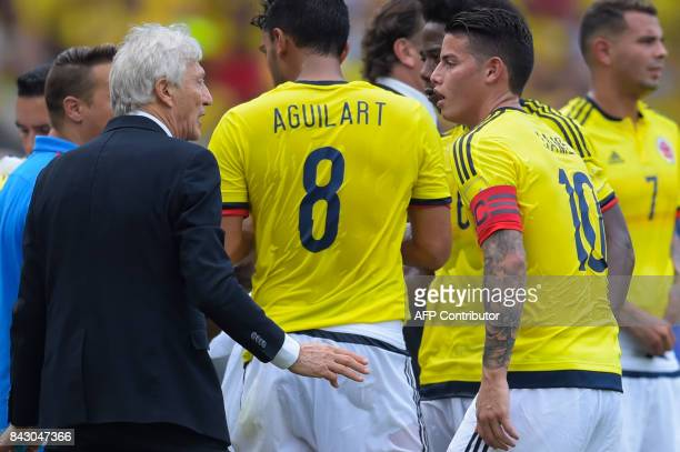Colombia's coach Jose Pekerman gives instructions to his players during the 2018 World Cup football qualifier match against Brazil in Barranquilla...