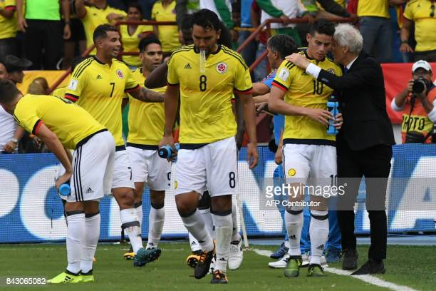 Colombia's coach Jose Pekerman gives instructions to James Rodriguez during the 2018 World Cup football qualifier match against Brazil in...