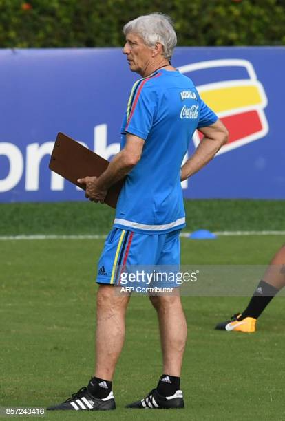 Colombia's coach Jose Pekerman looks at his players during a training session at the Metropolitano Stadium in Barranquilla on October 3 ahead of...