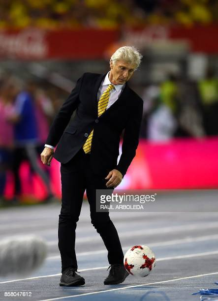 Colombia's coach Jose Pekerman reacts to a ball hitting his foot during the 2018 World Cup football qualifier match against Paraguay in Barranquilla...