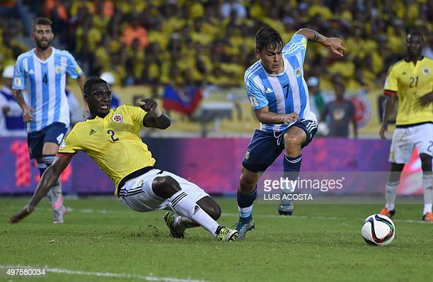 Colombia's Cristian Zapata and Argentina's Paulo Dybala vie for the ball during their Russia 2018 FIFA World Cup South American Qualifiers football...