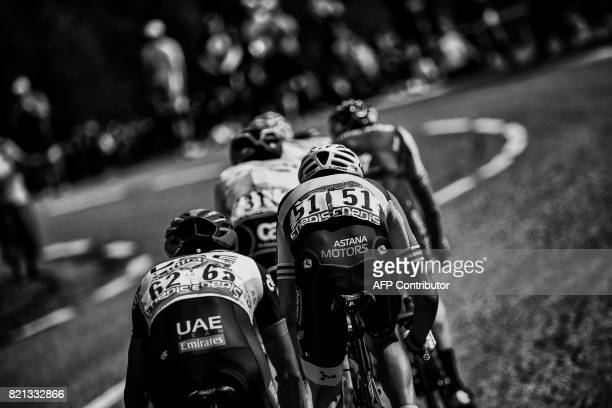 Colombia's Darwin Atapuma Italy's Fabio Aru and Spain's Alberto Contador ride in a breakaway during the 183 km seventeenth stage of the 104th edition...