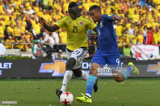 Colombia's Davinson Sanchez and Brazil's Gabriel Jesus vie for the ball during their 2018 World Cup qualifier football match in Barranquilla Colombia...