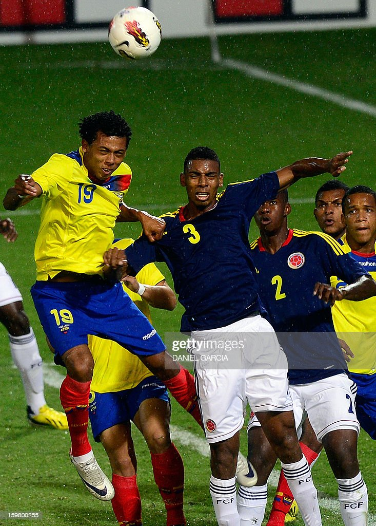 Colombia's defender Delvy Balanta (C-R) vies for the ball with Ecuadorean forward Jose Gutierrez during their South American U-20 final round football match at Malvinas Argentinas stadium in Mendoza, Argentina, on January 20, 2013. Four teams will qualify for the FIFA U-20 World Cup Turkey 2013.