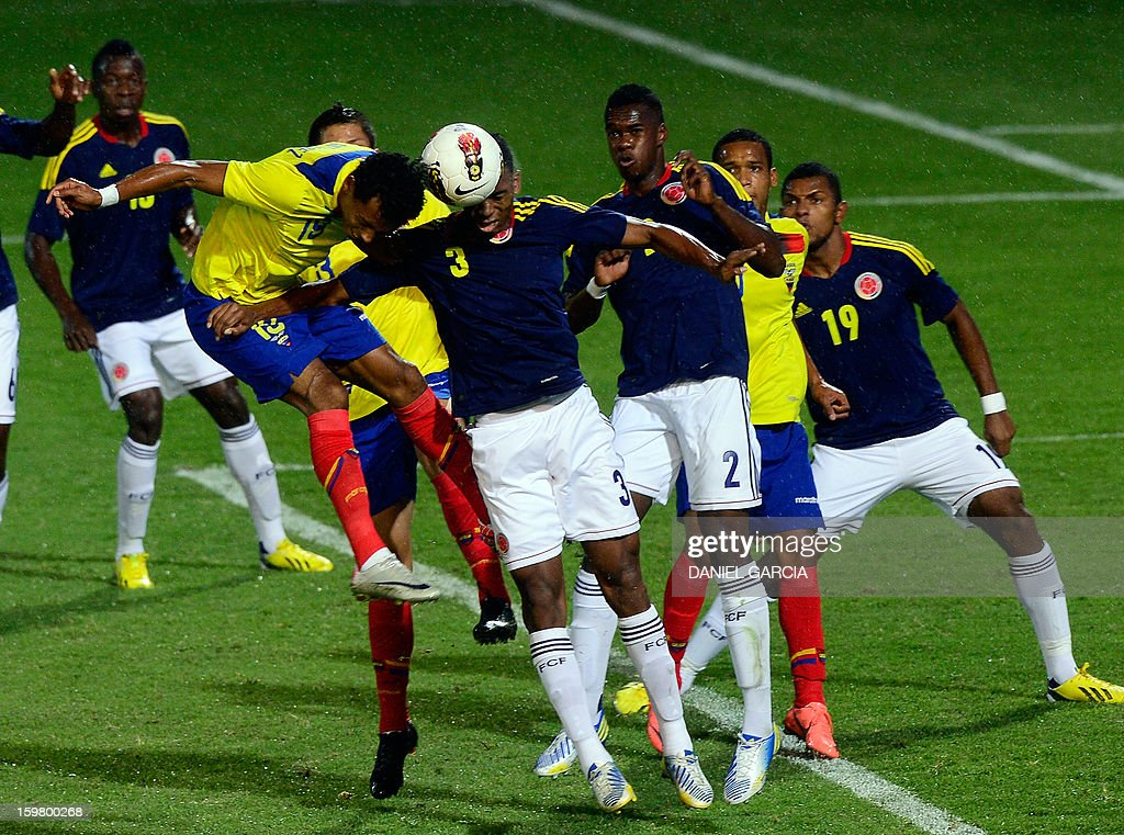 Colombia's defender Delvy Balanta (C) vies for the ball with Ecuadorean forward Jose Gutierrez during their South American U-20 final round football match at Malvinas Argentinas stadium in Mendoza, Argentina, on January 20, 2013. Four teams will qualify for the FIFA U-20 World Cup Turkey 2013.