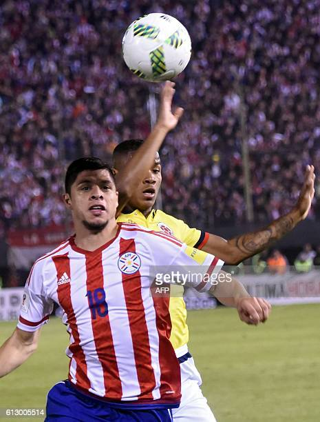 Colombia's defender Farid Diaz and Paraguay's Victor Ayala vie for the ball during their Russia 2018 World Cup qualifier football match in Asuncion...
