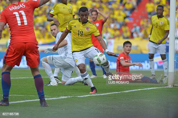 Colombia's defender Farid Diaz eyes the ball during the 2018 FIFA World Cup qualifier football match against Chile in Barranquilla Colombia on...