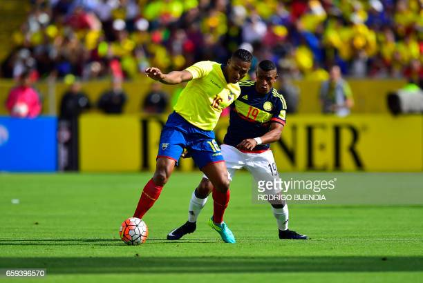 Colombia's defender Farid Diaz vies for the ball with Ecuador's Luis Antonio Valencia during their 2018 FIFA World Cup qualifier football match in...