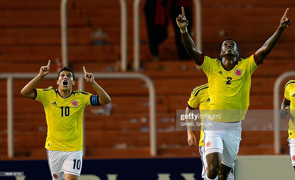 Colombia's defender Jherson Vergara celebrates next to midfielder Juan Quintero (L) after scoring the team's second goal against Paraguay, during their South American U-20 final round football match at Malvinas Argentinas stadium in Mendoza, Argentina, on February 3, 2013. Paraguay, Colombia, Uruguay and Chile qualified for the FIFA U-20 World Cup Turkey 2013.