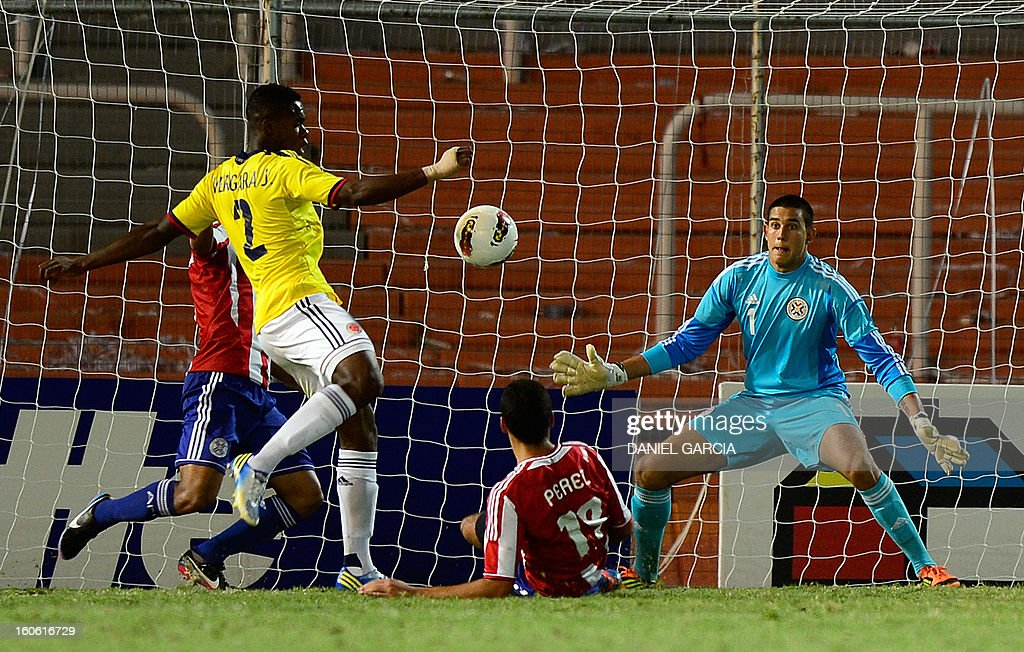 Colombia's defender Jherson Vergara (2nd L) prepares to shoot and score the team's second goal agaisnt Paraguay, during their South American U-20 final round football match, at Malvinas Argentinas stadium in Mendoza, Argentina, on February 3, 2013. Paraguay, Colombia, Uruguay and Chile qualified for the FIFA U-20 World Cup Turkey 2013.