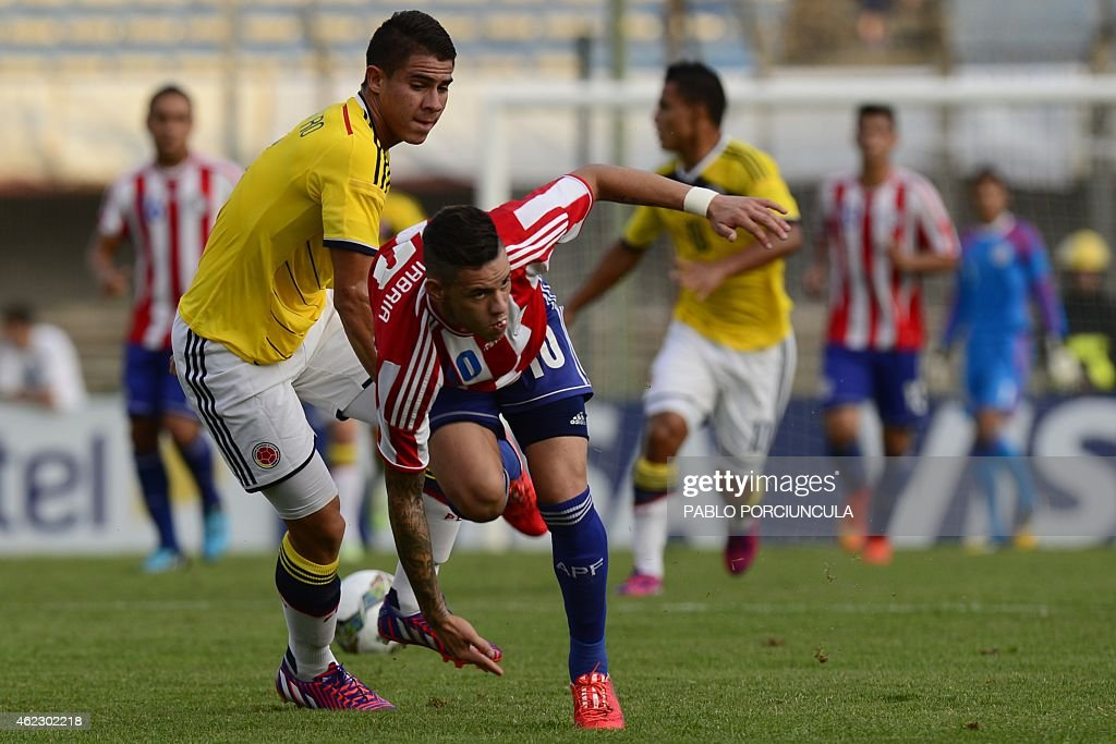 Colombia's defender Juan Quintero and Paraguay's forward Antonio Sanabria vie for the ball during the South American U20 football match at the...
