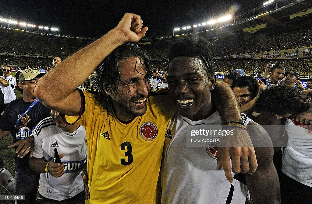 Colombia's defender Mario Yepes (L) and midfielder Carlos Sanchez celebrate after qualifying for the Brazil 2014 FIFA World Cup after a 3-3 tie with Chile in a South American qualifier match, in Barranquilla, Colombia, on October 11, 2013.