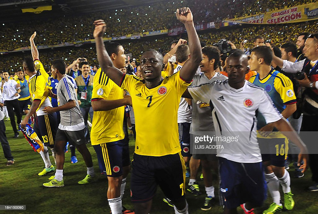 Colombia's defender Pablo Armero celebrates after qualifying for the Brazil 2014 FIFA World Cup after a 3-3 tie with Chile in a South American qualifier match, in Barranquilla, Colombia, on October 11, 2013.