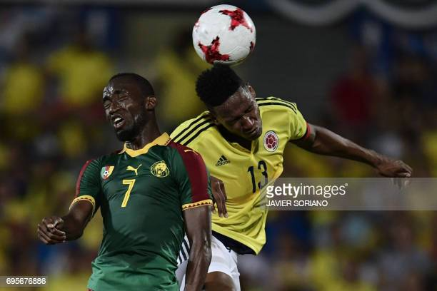 Colombia's defender Yerri Mina vies with Cameroon's forward Nicolas Ngamelu during the friendly football match Cameroon vs Colombia at the Col...