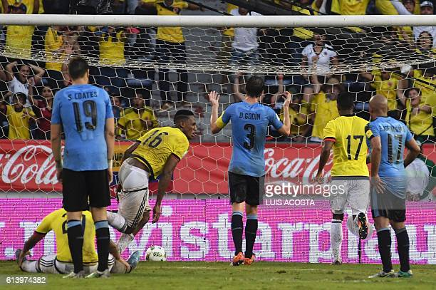 Colombia's defender Yerry Mina scores against Uruguay during their Russia 2018 World Cup qualifier football match in Barranquilla Colombia on October...