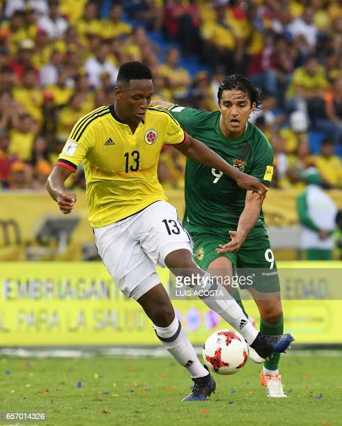 Colombia's defender Yerry Mina vies for the ball with Bolivia's forward Marcelo Martins during their 2018 FIFA World Cup qualifier football match in...