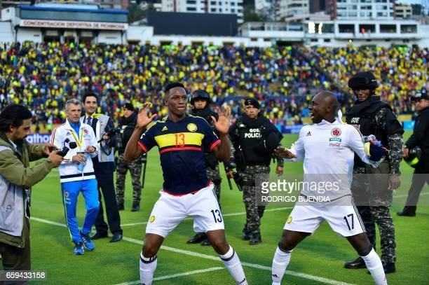 Colombia's defenders Yerry Mina and Pablo Armero celebrate after winning 20 their 2018 FIFA World Cup qualifier football match against Ecuador in...