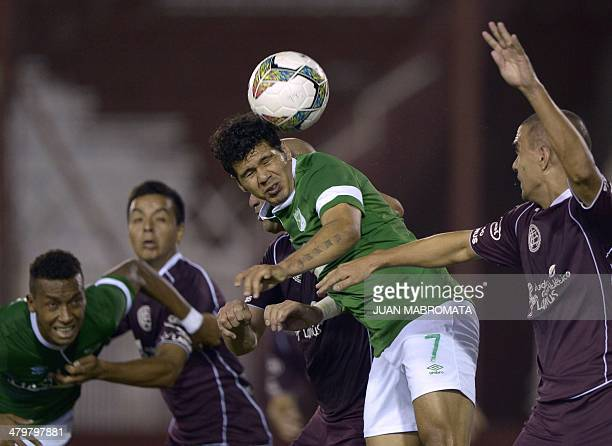 Colombia's Deportivo Cali forward Robin Ramirez heads the ball during the Libertadores Cup group 3 football match against Argentina's Lanus at Lanus...
