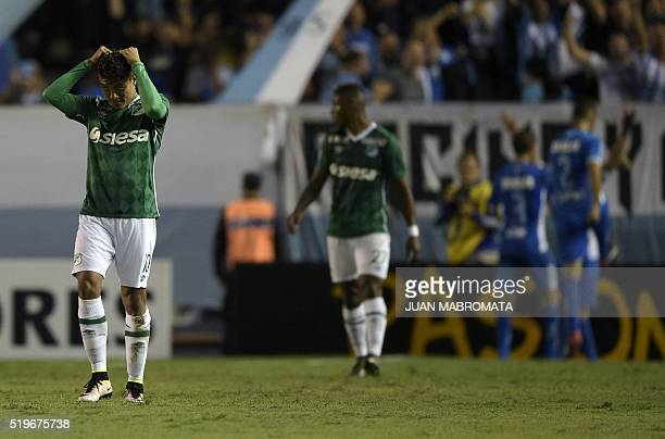 Colombia's Deportivo Cali midfielder Andres Roa reacts after being scored for the second time by Argentina's Racing Club forward Lisandro Lopez...