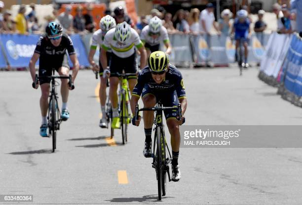 Colombia's Esteban Chaves of OricaScott outsprints threetime Tour de France winner Britain's Chris Froome of Team Sky to the top of Falls Creek in...