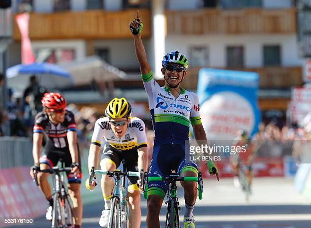 Colombia's Esteban Chaves of team Orica celebrates as he crosses the finish line to win the 14th stage of the 99th Giro d'Italia Tour of Italy from...