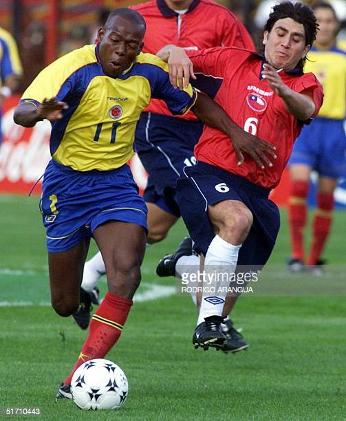 Colombia's Faustino Asprilla fights for the ball with Chile's Patricio Ormazabal 07 November 2001 at El Campin Stadium in Bogota during their World...