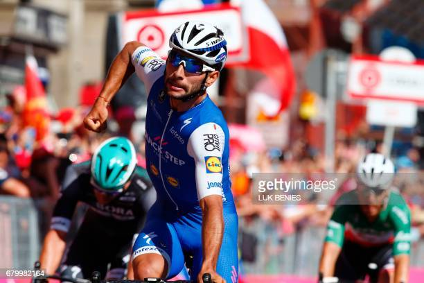 Colombia's Fernando Gaviria of team QuickStep celebrates as he crosses the finish line to win the third stage of the 100th Giro d'Italia Tour of...
