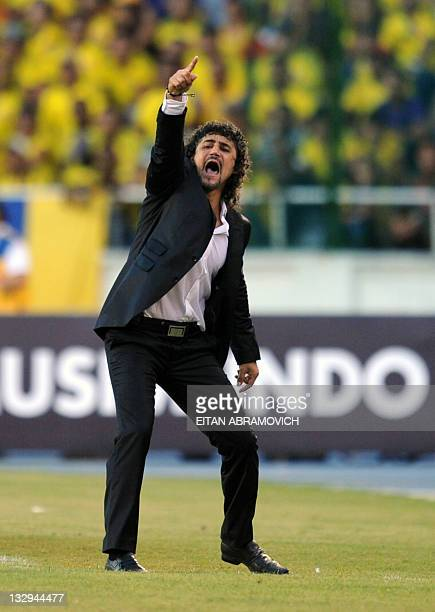 Colombia's football team coach Leonel Alvarez gestures during the Brazil 2014 FIFA World Cup South American qualifier match against Argentina at the...