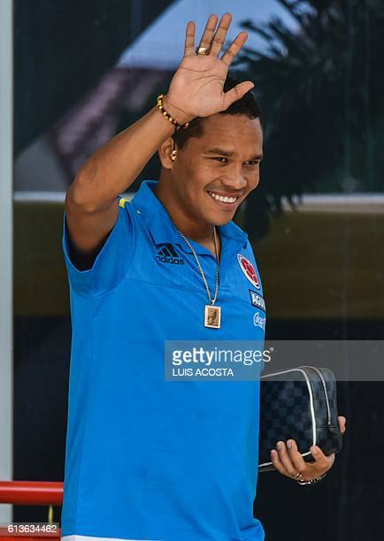 Colombia's football team player Carlos Bacca waves to fans before a training session in Barranquilla Colombia on October 9 2016 ahead of a Russia...