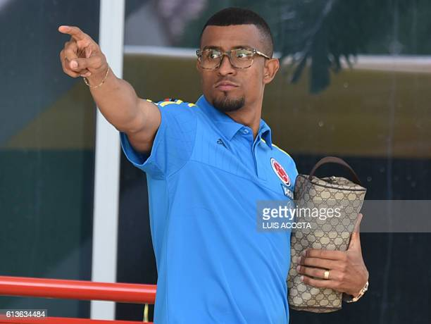 Colombia's football team player Farid Diaz points at fans before a training session in Barranquilla Colombia on October 9 2016 ahead of a Russia 2018...