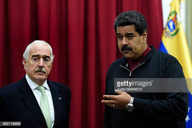 Colombia's former president and an observer for Venezuela's legislative elections Andres Pastrana and Venezuelan President Nicolas Maduro gesture...