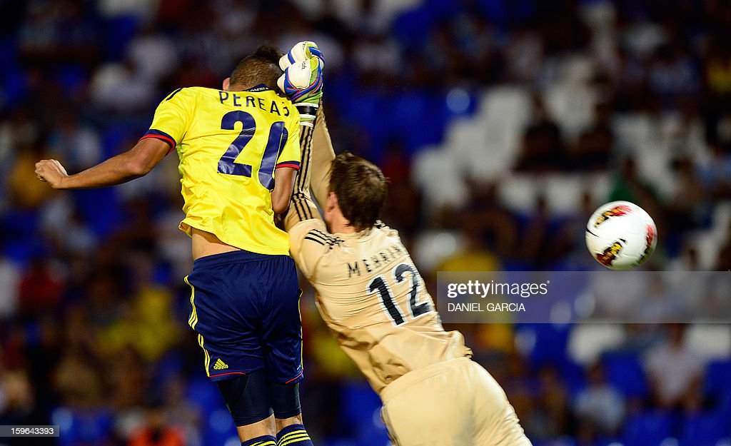 Colombia's forward Brayan Perea heads the ball to score past Argentina's goalkeeper Andres Mehring during their South American U-20 Group A football match at Malvinas Argentinas stadium in Mendoza, Argentina, on January 17, 2013. Four teams will qualify for the Turkey 2013 FIFA U-20 World Cup.