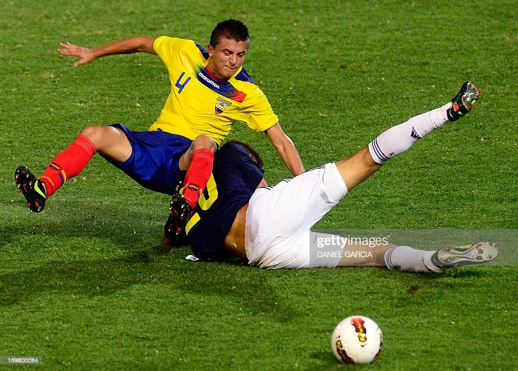 Colombia's forward Brayan Perea vies for the ball with Ecuadorean defender Marcos Lopez (L) during their South American U-20 final round football match at Malvinas Argentinas stadium in Mendoza, Argentina, on January 20, 2013. Four teams will qualify for the FIFA U-20 World Cup Turkey 2013.