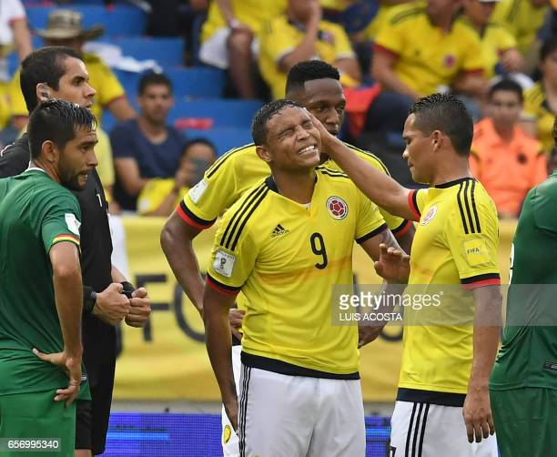 Colombia's forward Carlos Bacca comforts Colombia's forward Luis Muriel during their 2018 FIFA World Cup qualifier football match in Barranquilla...