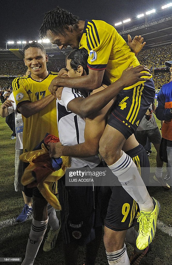 Colombia's forward Carlos Bacca (L), Radamel Falcao Garcia (9) and Juan Cuadrado celebrate after qualifying for the Brazil 2014 FIFA World Cup after a 3-3 tie with Chile in a South American qualifier match, in Barranquilla, Colombia, on October 11, 2013. AFP PHOTO / LUIS ACOSTA
