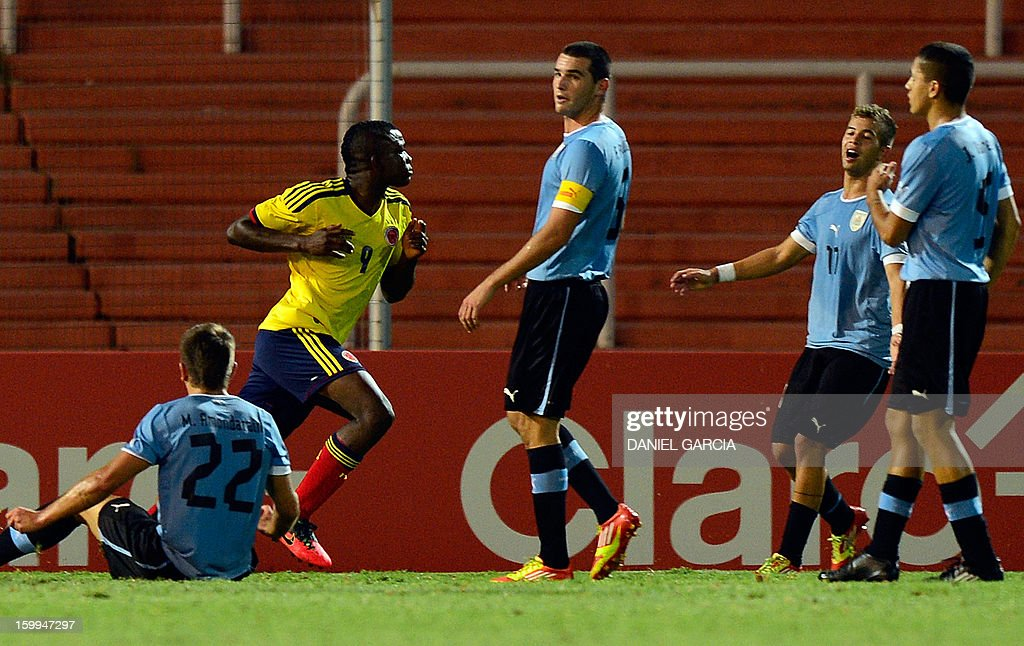 Colombia's forward Jhon Cordoba (2-L) celebrates after scoring against Uruguay during their South American U-20 final round football match at Malvinas Argentinas stadium in Mendoza, Argentina, on January 23, 2013. Four South American teams will qualify for the FIFA U-20 World Cup Turkey 2013. AFP PHOTO / DANIEL GARCIA