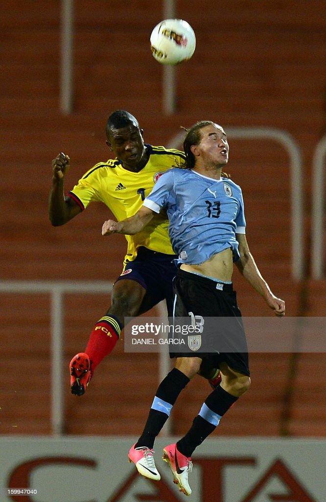 Colombia's forward Jhon Cordoba vies for the ball with Uruguay's midfielder Diego Laxalt Suarez during their South American U-20 final round football match at Malvinas Argentinas stadium in Mendoza, Argentina, on January 23, 2013. Four teams will qualify for the FIFA U-20 World Cup Turkey 2013. AFP PHOTO / DANIEL GARCIA